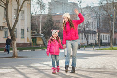 Two girls walking  in the city. Royalty Free Stock Photography