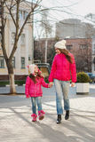 Two girls walking  in the city. Stock Image