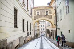Two girls walking down street under arch. Two girls walking down the street under the arch Prague Stock Photos
