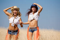 Two girls are walking at the field Stock Photography