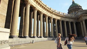 Two girls walking near The Kazan Cathedral. HD 1080p: Two girls walking near the Kazan Cathedral in the summer. The camera turns on a course of their movement stock video footage