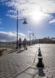 Two girls walking past the harbor harbour Royalty Free Stock Image