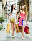 Two girls walking with shopping Royalty Free Stock Images