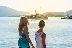 Two girls walking at the shore Royalty Free Stock Image