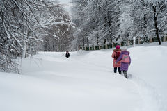 Two girls walking in the snow. Russia Royalty Free Stock Photography