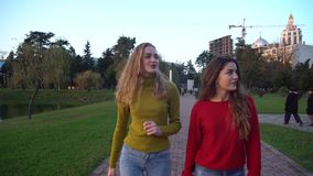 Two girls walking and talking at park in Batumi.  stock video
