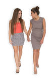 Two girls walking together Stock Photos