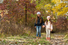 Two girls walking in the woods Royalty Free Stock Photo