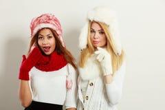 Two girls warm winter clothing having fun. Royalty Free Stock Images