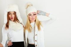 Two girls in warm winter clothing having fun. Stock Photo
