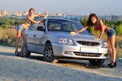 Two Girls Washing Car Stock Photos