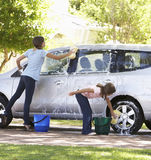 Two Girls Washing Car Together Stock Photo