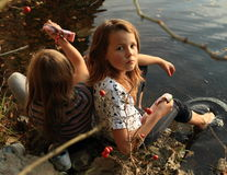 Two girls washing their feet Stock Photography