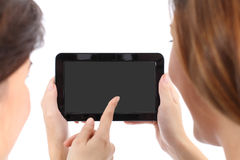 Two girls watching a blank tablet screen Stock Photo