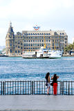 Two girls watching Haydarpaşa train station Stock Images