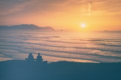 Two girls watching the sunset. Two girls watching at the sunset Royalty Free Stock Images
