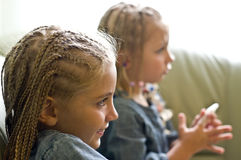 Two girls watching television royalty free stock photo