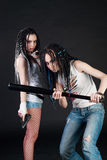 Two girls with weapons Stock Photo