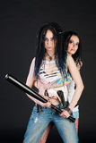 Two girls with weapons Stock Photography
