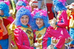 Two girls wearing bright costumes and blue wigs in carnival parade at the City Day in Volgograd Royalty Free Stock Photos