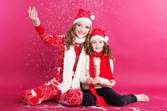 Two girls are wearing christmas clothes Royalty Free Stock Images