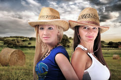 Two Girls Wearing cowboy Hats Stock Photo