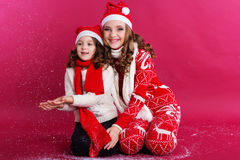 Two girls are wearing winter clothes in studio Stock Images