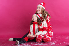 Two girls are wearing winter clothes in studio Royalty Free Stock Photography