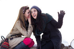 Two girls whispering Royalty Free Stock Photos