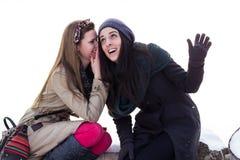 Two girls whispering Royalty Free Stock Photos