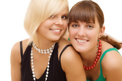Two girls on white background. Two smiling pretty girls on white background Stock Image