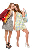 Two girls on a white background with bags Royalty Free Stock Photography