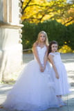 Two girls in white dresses Stock Images