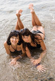 Two girls on wild seashore Stock Photo