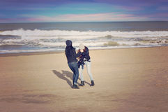 Two girls in the winter beach. Two teenagers playing in winter in a beach of Mar del Plata, Argentina Stock Photos