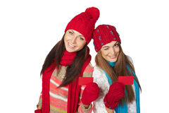 Two girls in winter clothing showing credit cards Stock Image