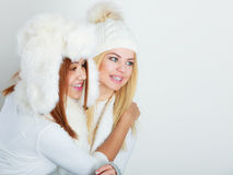 Two girls in winter clothing warm cap Stock Photos