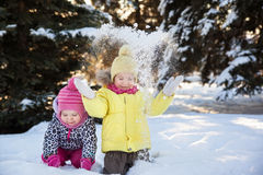 Two girls in winter forest Stock Photography
