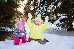 Two girls in winter forest Stock Photos