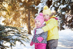 Two girls in winter forest Stock Images