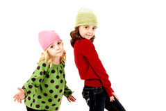 Two girls in winter hats with fun expression Royalty Free Stock Image
