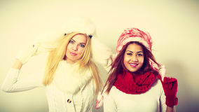 Two girls with winter outfit. Royalty Free Stock Photos