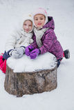 Two girls among winter park Stock Image