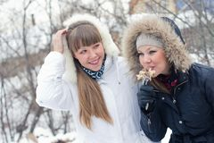 Two girls on winter picnic Royalty Free Stock Photo