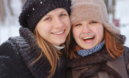 Two girls in a winter season stock images