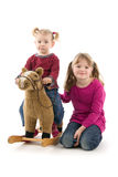 Two Girls With Rocking Horse Royalty Free Stock Image