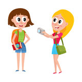 Two girls, women tourists travelling together, one posing to another Stock Photo