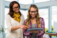 Two girls work at office Stock Images