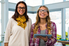 Two girls work at office Royalty Free Stock Photos