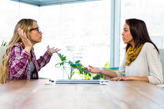 Two girls work at office Stock Photography